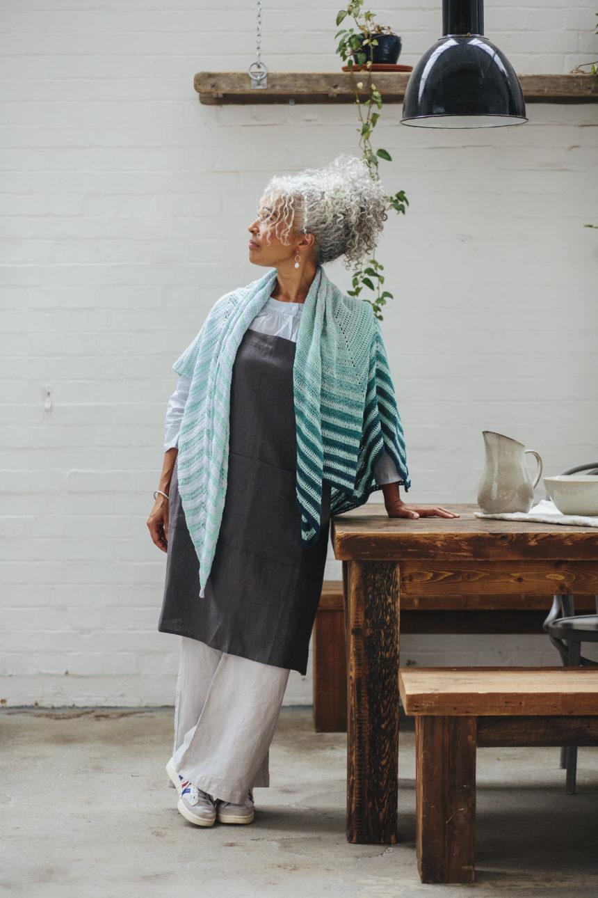 model wearing chevron boulevard shawl draped across shoulders