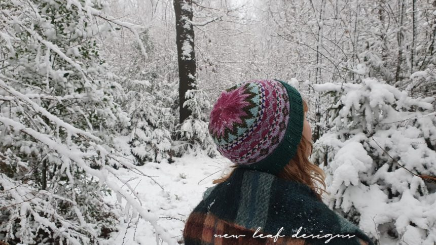 Carmen wearing Home Hat looking up at snowy trees