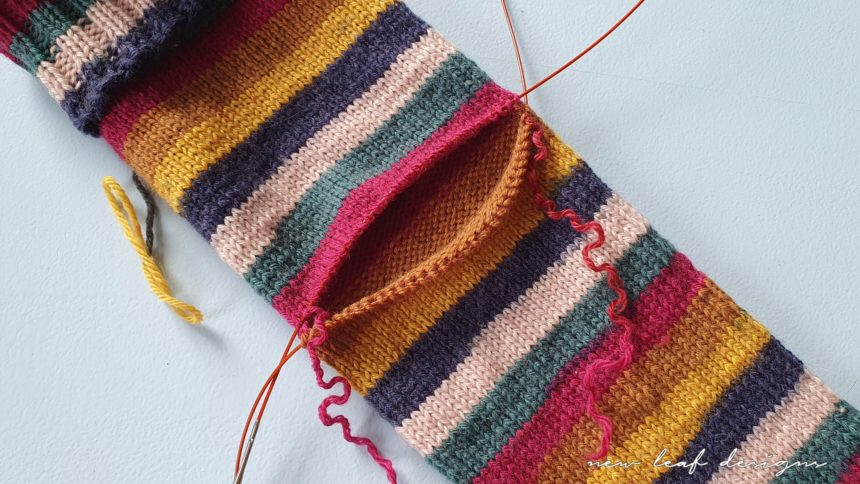 one row of stitches has been removed, there is now a gap in the sock where the heel can be placed.