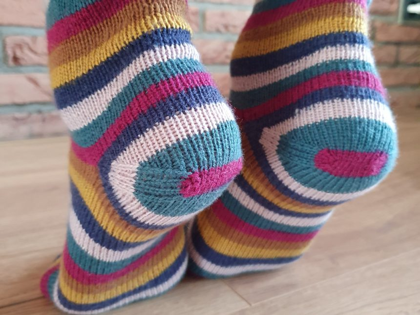 close up of the afterthought heels of a pair of socks, showing bulls eye striping effect
