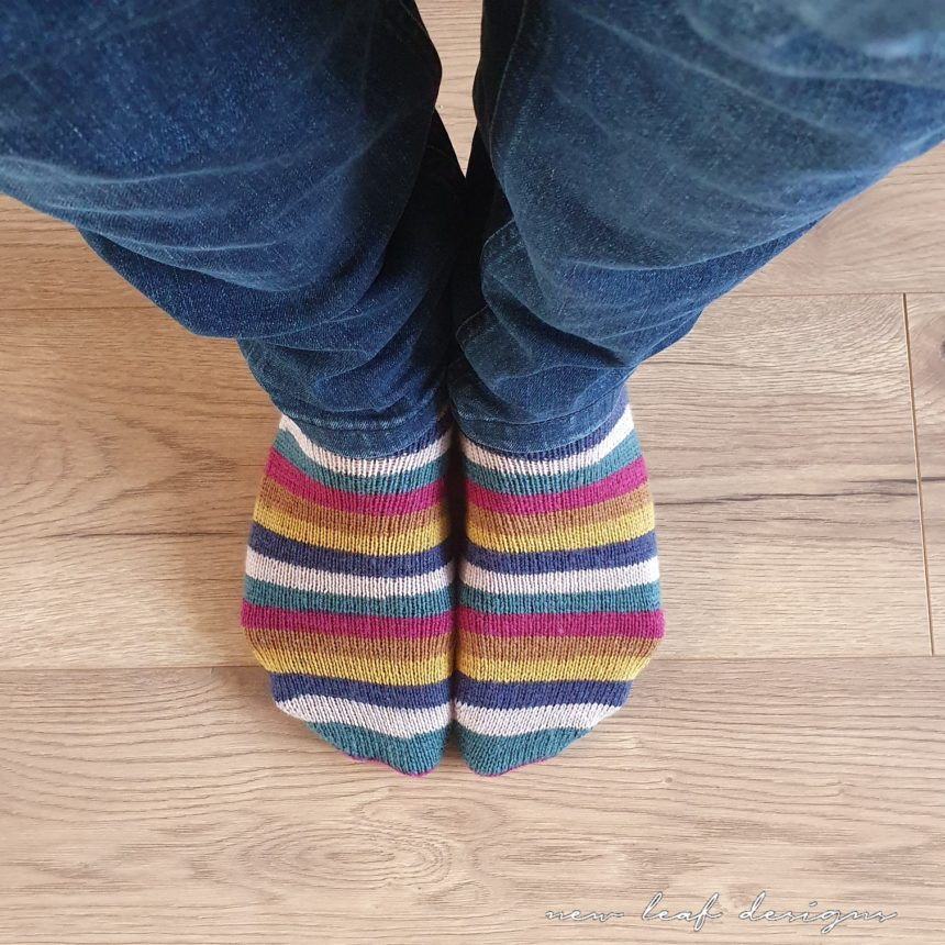 close up of two feet wearing socks, the image is taken while standing and looking down at feet